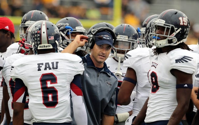 Nov 16, 2013; Hattiesburg, MS, USA; Florida Atlantic Owls head coach Brian Wright talks to his players during their game against the Southern Miss Golden Eagles in the first half at M.M. Roberts Stadium. Mandatory Credit: Chuck Cook-USA TODAY Sports