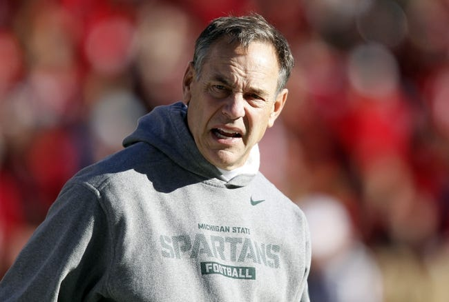 Nov 16, 2013; Lincoln, NE, USA; Michigan State Spartans head coach Mark Dantonio watches his team warm up prior to the game against the Nebraska Cornhuskers at Memorial Stadium. Mandatory Credit: Bruce Thorson-USA TODAY Sports