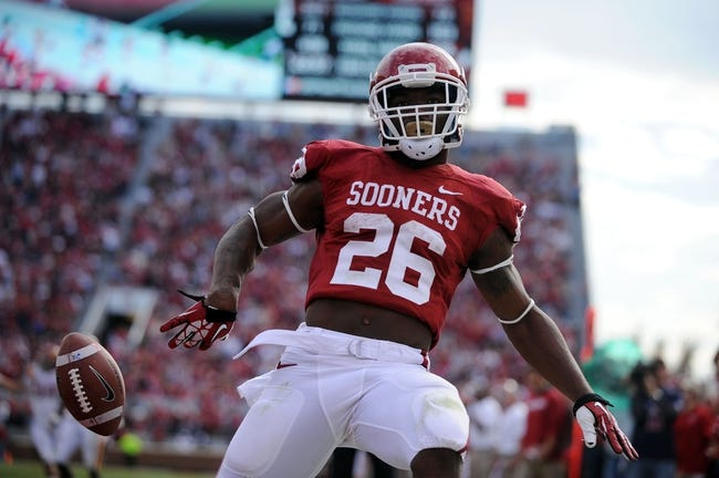 Nov 16, 2013; Norman, OK, USA; Oklahoma Sooners running back Damien Williams (26) celebrates a touchdown against the Iowa State Cyclones in the second half at Gaylord Family - Oklahoma Memorial Stadium. Mandatory Credit: Mark D. Smith-USA TODAY Sports
