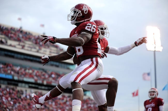 Nov 16, 2013; Norman, OK, USA; Oklahoma Sooners running back Damien Williams (26) celebrates a touchdown with Sooners wide receiver Lacoltan Bester (11) against the Iowa State Cyclones in the second half at Gaylord Family - Oklahoma Memorial Stadium. Mandatory Credit: Mark D. Smith-USA TODAY Sports