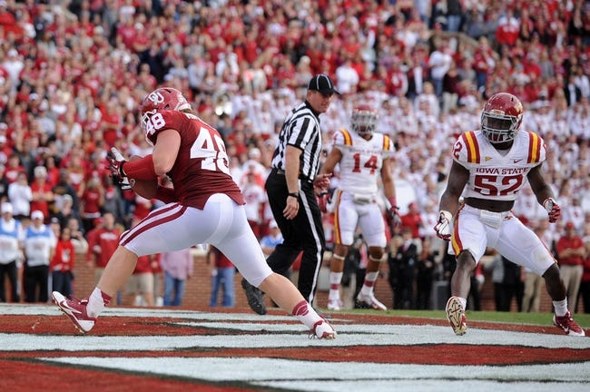 Nov 16, 2013; Norman, OK, USA; Oklahoma Sooners fullback Aaron Ripkowski (48) catches a pass in the end zone while being defended by Iowa State Cyclones linebacker jeremiah George (52) in the second half at Gaylord Family - Oklahoma Memorial Stadium. Mandatory Credit: Mark D. Smith-USA TODAY Sports
