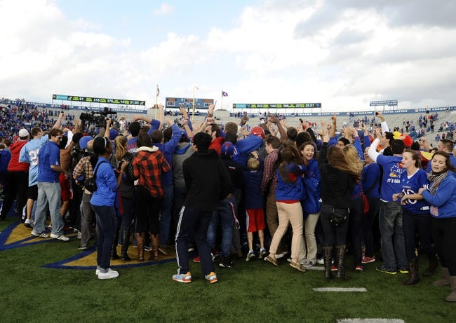 Nov 16, 2013; Lawrence, KS, USA; Kansas Jayhawks students celebrate after the win against the West Virginia Mountaineers at Memorial Stadium. Kansas won the game 31-19. Mandatory Credit: John Rieger-USA TODAY Sports