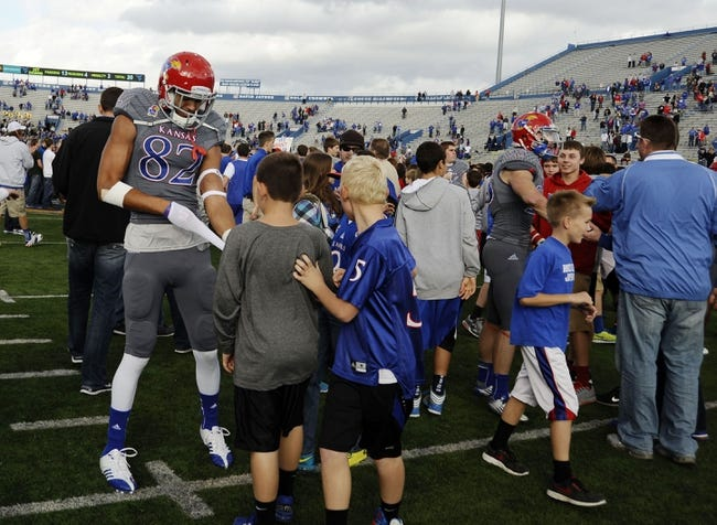Nov 16, 2013; Lawrence, KS, USA; Kansas Jayhawks wide receiver Andrew Turzilli (82) is congratulated by fans after the win against the West Virginia Mountaineers at Memorial Stadium. Kansas won the game 31-19. Mandatory Credit: John Rieger-USA TODAY Sports