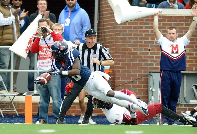Nov 16, 2013; Oxford, MS, USA; Mississippi Rebels running back Jaylen Walton (6) dives into the end zone while being tackled by Troy Trojans safety Rishad Goode (14) during the third quarter at Vaught-Hemingway Stadium. Mississippi Rebels beat the Troy Trojans 51-21. Mandatory Credit: Justin Ford-USA TODAY Sports