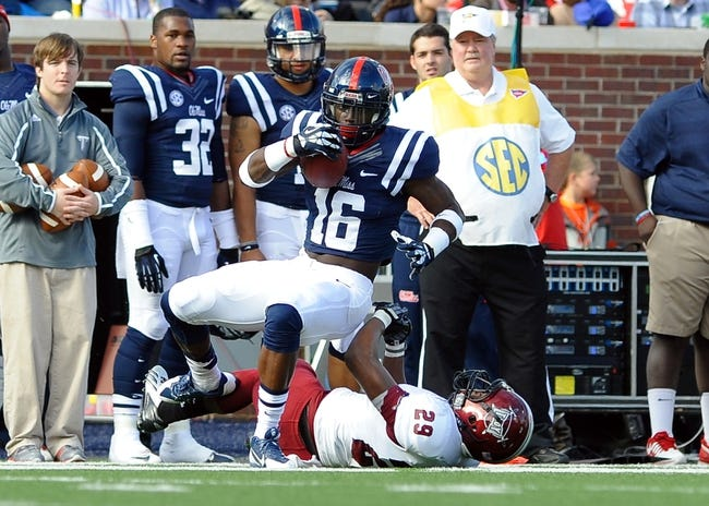 Nov 16, 2013; Oxford, MS, USA; Troy Trojans safety JaQuadrian Lewis (29) tackles Mississippi Rebels wide receiver Collins Moore (16)  during the third quarter at Vaught-Hemingway Stadium. Mississippi Rebels beat the Troy Trojans 51-21. Mandatory Credit: Justin Ford-USA TODAY Sports
