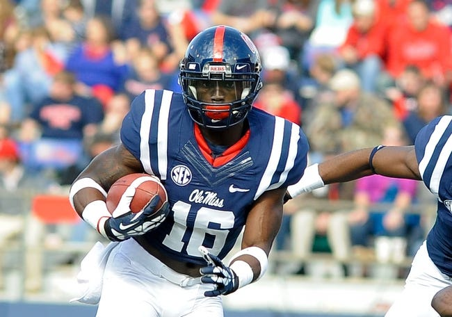 Nov 16, 2013; Oxford, MS, USA; Mississippi Rebels wide receiver Collins Moore (16) brings the ball up the field against the Troy Trojans during the third quarter at Vaught-Hemingway Stadium. Mississippi Rebels beat the Troy Trojans 51-21. Mandatory Credit: Justin Ford-USA TODAY Sports