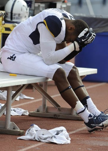 Nov 16, 2013; Lawrence, KS, USA; West Virginia Mountaineers cornerback Daryl Worley (7) sits on the bench against the Kansas Jayhawks in the second half at Memorial Stadium. Kansas won the game 31-19. Mandatory Credit: John Rieger-USA TODAY Sports