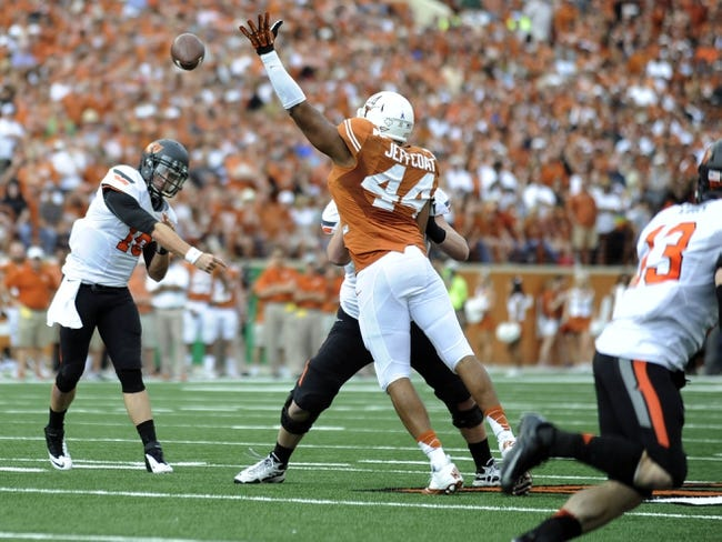 Nov 16, 2013; Austin, TX, USA; Texas Longhorns defensive end Jackson Jeffcoat (44) blocks a pass thrown by Oklahoma State Cowboys quarterback Clint Chelf (10) during the first quarter at Darrell K Royal-Texas Memorial Stadium. Mandatory Credit: Brendan Maloney-USA TODAY Sports