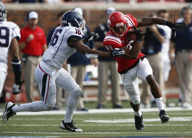 Nov 16, 2013; Dallas, TX, USA; Southern Methodist Mustangs wide receiver Keenan Holman (81) runs after a catch against Connecticut Huskies cornerback Byron Jones (16) during the first half on an NCAA football game at Gerald J. Ford Stadium. Mandatory Credit: Jim Cowsert-USA TODAY Sports