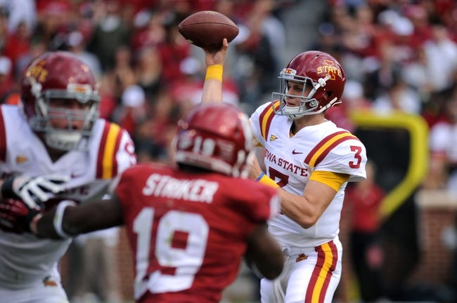 Nov 16, 2013; Norman, OK, USA; Iowa State Cyclones quarterback Grant Rohach (3) attempts a pass against Oklahoma Sooners linebacker Eric Striker (19) in the second half at Gaylord Family - Oklahoma Memorial Stadium. Mandatory Credit: Mark D. Smith-USA TODAY Sports