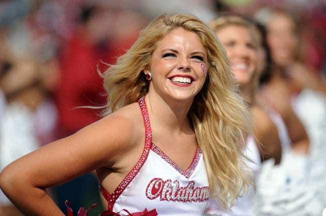 Nov 16, 2013; Norman, OK, USA; A member of the Oklahoma Sooners spirit squad reacts to a play in action against the Iowa State Cyclones in the second half at Gaylord Family - Oklahoma Memorial Stadium. Mandatory Credit: Mark D. Smith-USA TODAY Sports