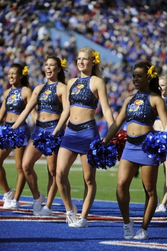 Nov 16, 2013; Lawrence, KS, USA; Kansas Jayhawks cheerleaders perform against the West Virginia Mountaineers in the second half at Memorial Stadium. Kansas won the game 31-19. Mandatory Credit: John Rieger-USA TODAY Sports