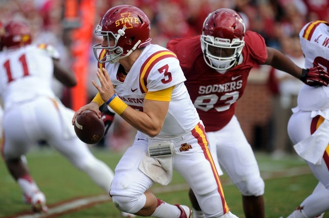 Nov 16, 2013; Norman, OK, USA; Iowa State Cyclones quarterback Grant Rohach (3) scrambles with the ball while being pursued by Oklahoma Sooners defensive tackle Jordan Wade (93) in the second half at Gaylord Family - Oklahoma Memorial Stadium. Mandatory Credit: Mark D. Smith-USA TODAY Sports