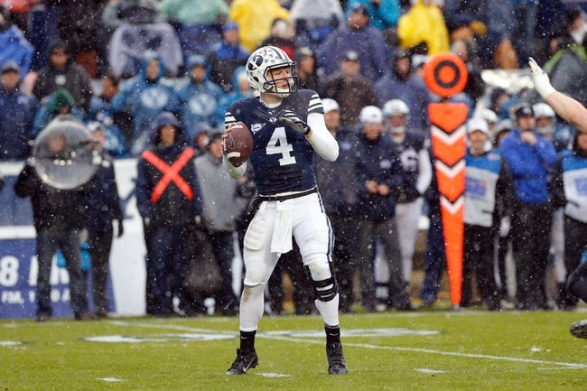 Nov 16, 2013; Provo, UT, USA; Brigham Young Cougars quarterback Taysom Hill (4) looks to throw the ball against the Idaho State Bengals in the first quarter at Lavell Edwards Stadium. Mandatory Credit: Chris Nicoll-USA TODAY Sports