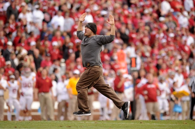 Nov 16, 2013; Norman, OK, USA; An unidentified man runs around on the field stopping action between the Oklahoma Sooners and the Iowa State Cyclones in the second half at Gaylord Family - Oklahoma Memorial Stadium. Mandatory Credit: Mark D. Smith-USA TODAY Sports