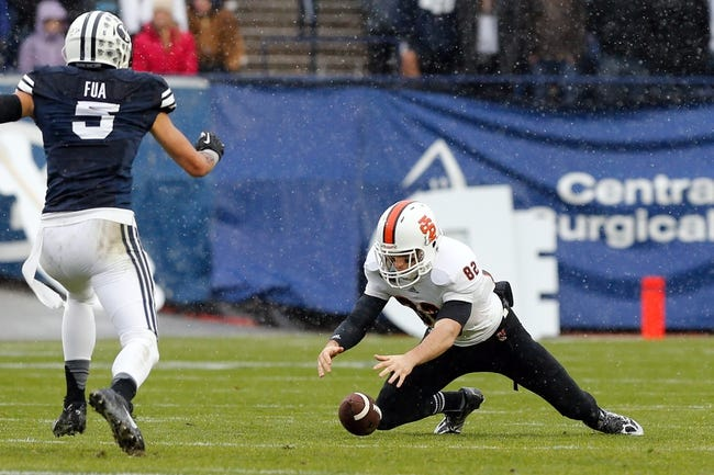 Nov 16, 2013; Provo, UT, USA; Idaho State Bengals wide receiver Luke Austin (82) jumps on to a loose ball during the game against the Brigham Young Cougars in the first quarter at Lavell Edwards Stadium. Mandatory Credit: Chris Nicoll-USA TODAY Sports
