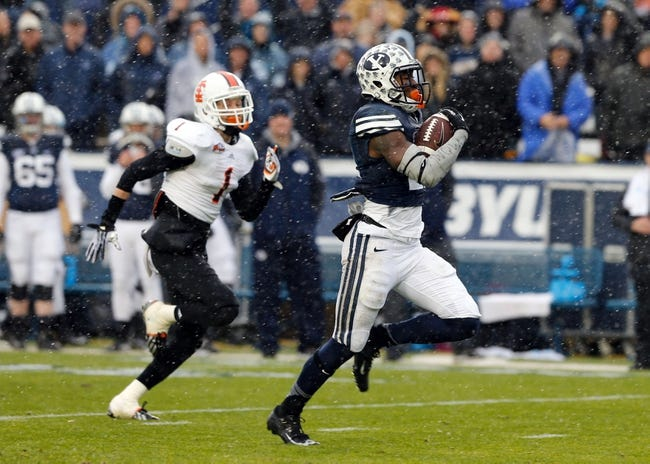 Nov 16, 2013; Provo, UT, USA; Brigham Young Cougars running back Jamaal Williams (21) out runs Idaho State Bengals defensive back John Davidson (1) and scores a touchdown in the first quarter at Lavell Edwards Stadium. Mandatory Credit: Chris Nicoll-USA TODAY Sports