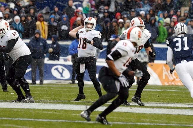 Nov 16, 2013; Provo, UT, USA; Idaho State Bengals quarterback Justin Arias (18) looks to throw the ball in the first quarter against the Brigham Young Cougars at Lavell Edwards Stadium. Mandatory Credit: Chris Nicoll-USA TODAY Sports