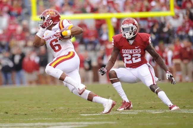 Nov 16, 2013; Norman, OK, USA; Iowa State Cyclones wide receiver Tad Ecby (6) runs with the ball while being pursued by Oklahoma Sooners defensive back Cortez Johnson (22) in the second half at Gaylord Family - Oklahoma Memorial Stadium. Mandatory Credit: Mark D. Smith-USA TODAY Sports