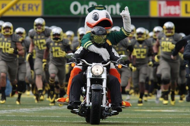 Nov 16, 2013; Eugene, OR, USA; Oregon Ducks mascot rides onto the filed prior to the game against the Utah Utes at Autzen Stadium. Mandatory Credit: Scott Olmos-USA TODAY Sports