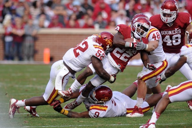 Nov 16, 2013; Norman, OK, USA; Oklahoma Sooners running back Roy Finch (22) is tackled by Iowa State Cyclones linebacker Jeremiah George (52) and Cyclones defensive end Corey Morrissey (48) in the second half at Gaylord Family - Oklahoma Memorial Stadium. Mandatory Credit: Mark D. Smith-USA TODAY Sports