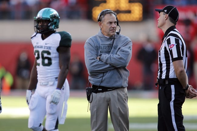 Nov 16, 2013; Lincoln, NE, USA; Michigan State Spartans head coach Mark Dantonio talks with an official during the game against the Nebraska Cornhuskers in the first quarter at Memorial Stadium. Mandatory Credit: Bruce Thorson-USA TODAY Sports
