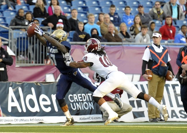 Nov 16, 2013; Foxborough, MA, USA; Akron Zips running back Jawon Chisholm (7) scores a touchdown past Massachusetts Minutemen defensive back Devin Brown (10) during the second half at Gillette Stadium. Mandatory Credit: Bob DeChiara-USA TODAY Sports