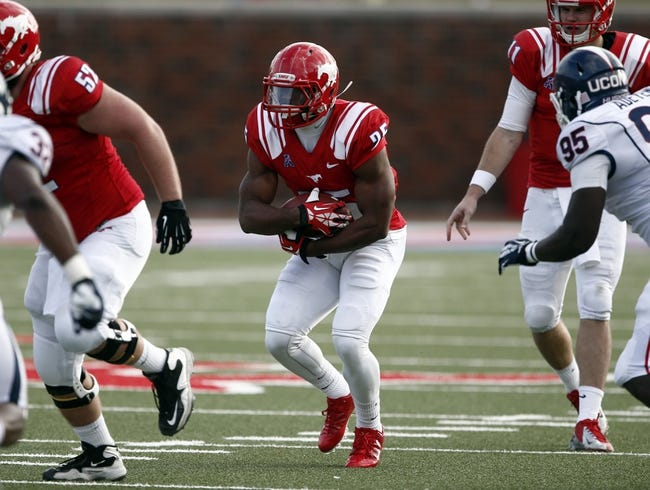 Nov 16, 2013; Dallas, TX, USA; Southern Methodist Mustangs running back K.C. Nlemchi (25) rushes against the Connecticut Huskies during the first half on an NCAA football game at Gerald J. Ford Stadium. Mandatory Credit: Jim Cowsert-USA TODAY Sports