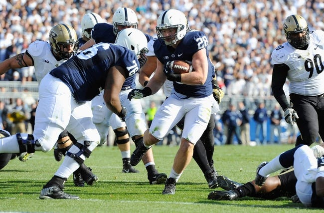 Nov 16, 2013; University Park, PA, USA; Penn State Nittany Lions running back Zach Zwinak (28) runs with the ball up field against the Purdue Boilermakers during the second quarter at Beaver Stadium. Penn State won 45-21.  Mandatory Credit: Rich Barnes-USA TODAY Sports