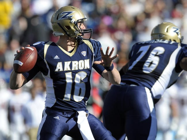 Nov 16, 2013; Foxborough, MA, USA; Akron Zips quarterback Kyle Pohl (16) drops back to pass during the first half against the Massachusetts Minutemen at Gillette Stadium. Mandatory Credit: Bob DeChiara-USA TODAY Sports
