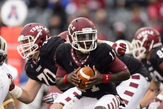 Nov 16, 2013; Philadelphia, PA, USA; Temple Owls quarterback P.J. Walker (11) drops back to pass during the third quarter against the UCF Knights at Lincoln Financial Field. UCF defeated Temple 39-36. Mandatory Credit: Howard Smith-USA TODAY Sports