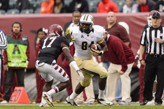 Nov 16, 2013; Philadelphia, PA, USA; Temple Owls defensive back Brandon Shippen (17) attempts to tackle UCF Knights tight end Justin Tukes (84) during the third quarter at Lincoln Financial Field. UCF defeated Temple 39-36. Mandatory Credit: Howard Smith-USA TODAY Sports