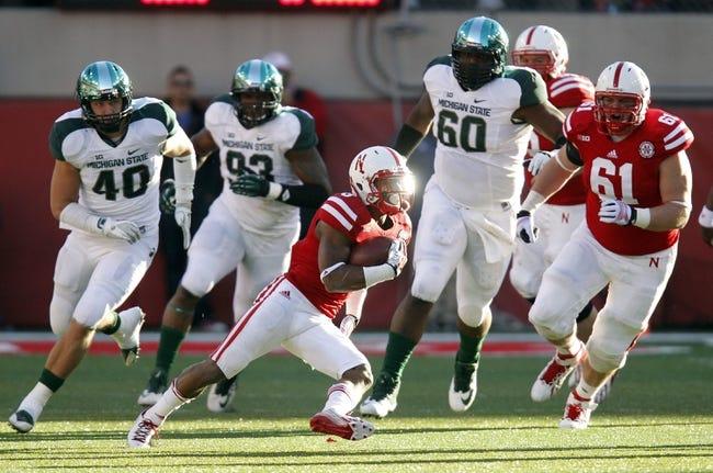 Nov 16, 2013; Lincoln, NE, USA; Nebraska Cornhuskers running back Ameer Abdullah (8) runs against the Michigan State Spartans in the second quarter at Memorial Stadium. Mandatory Credit: Bruce Thorson-USA TODAY Sports