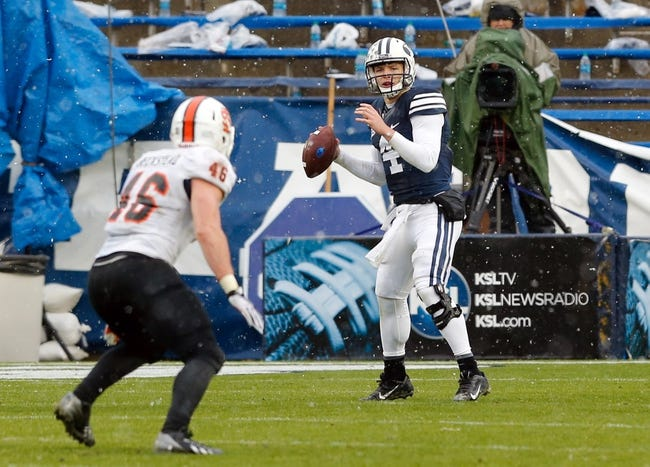 Nov 16, 2013; Provo, UT, USA; Brigham Young Cougars quarterback Taysom Hill (4) looks down the field to throw the ball against the Idaho State Bengals during the second quarter at Lavell Edwards Stadium. Mandatory Credit: Chris Nicoll-USA TODAY Sports
