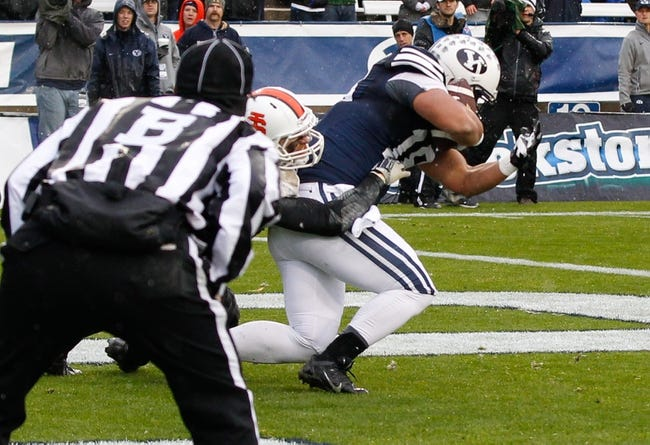 Nov 16, 2013; Provo, UT, USA; Brigham Young Cougars tight end Richard Wilson (18) catches the ball in the end zone and scores a touchdown against the Idaho State Bengals at Lavell Edwards Stadium. Mandatory Credit: Chris Nicoll-USA TODAY Sports