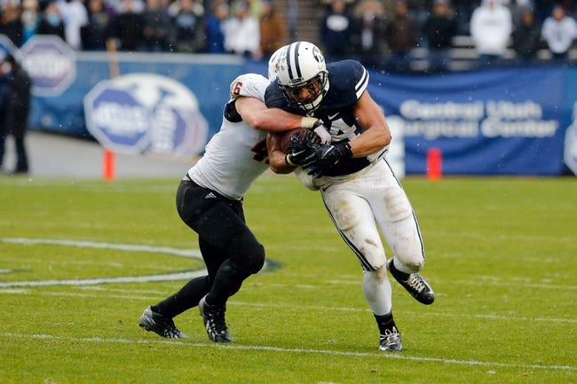 Nov 16, 2013; Provo, UT, USA; Idaho State Bengals linebacker Mitch Beckstead (46) tries to strip the ball from Brigham Young Cougars running back Algernon Brown (24) during the second quarter at Lavell Edwards Stadium. Mandatory Credit: Chris Nicoll-USA TODAY Sports