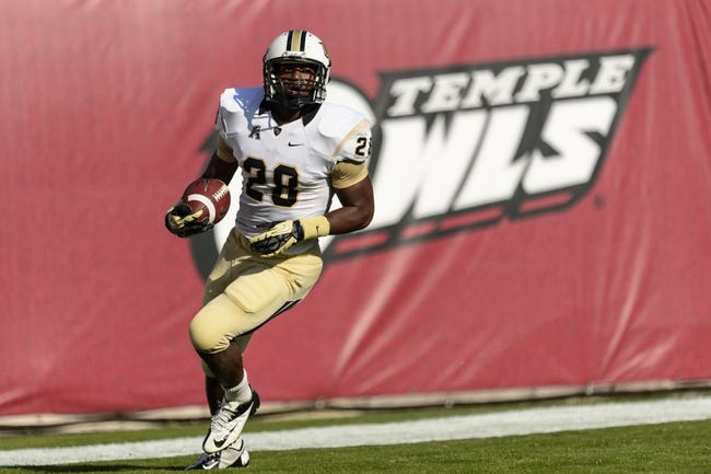 Nov 16, 2013; Philadelphia, PA, USA; UCF Knights running back William Stanback (28) scores a touchdown during the second quarter against the Temple Owls at Lincoln Financial Field. UCF defeated Temple 39-36. Mandatory Credit: Howard Smith-USA TODAY Sports