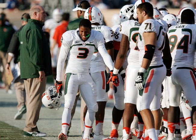 Nov 16, 2013; Durham, NC, USA; Miami Hurricanes wide receiver Stacy Coley (3) celebrates on the sidelines after scoring a touchdown against the Duke Blue Devils at Wallace Wade Stadium. Mandatory Credit: Mark Dolejs-USA TODAY Sports