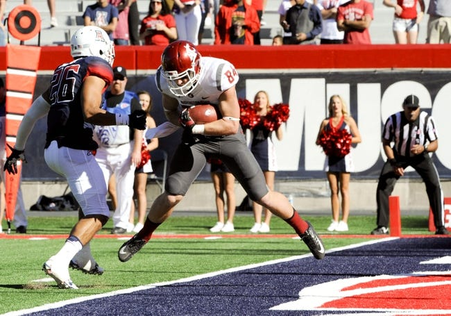 Nov 16, 2013; Tucson, AZ, USA; Washington State Cougars wide receiver River Cracraft (84) scores a touchdown as he is defended by Arizona Wildcats free safety Jourdon Grandon (26) during the third quarter at Arizona Stadium. The Cougars beat the Wildcats 24-17. Mandatory Credit: Casey Sapio-USA TODAY Sports