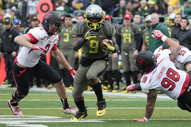 Nov 16, 2013; Eugene, OR, USA; Oregon Ducks running back Byron Marshall (9) runs with the ball as Utah Utes defensive tackle Viliseni Fauonuku (98) defends in the second quarter at Autzen Stadium. Mandatory Credit: Scott Olmos-USA TODAY Sports