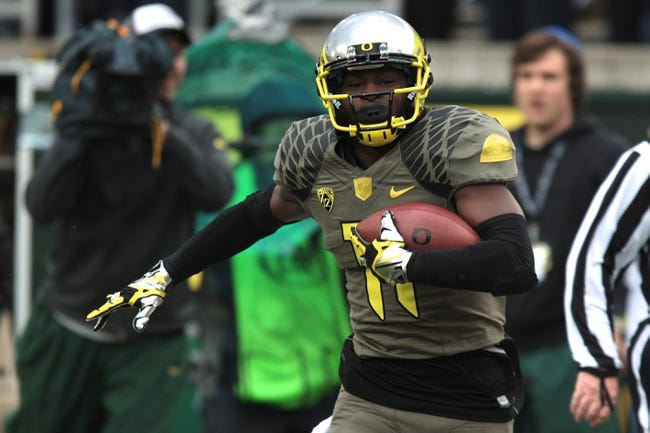 Nov 16, 2013; Eugene, OR, USA; Oregon Ducks wide receiver Bralon Addison (11) runs with the ball against the Utah Utes at Autzen Stadium. Mandatory Credit: Scott Olmos-USA TODAY Sports