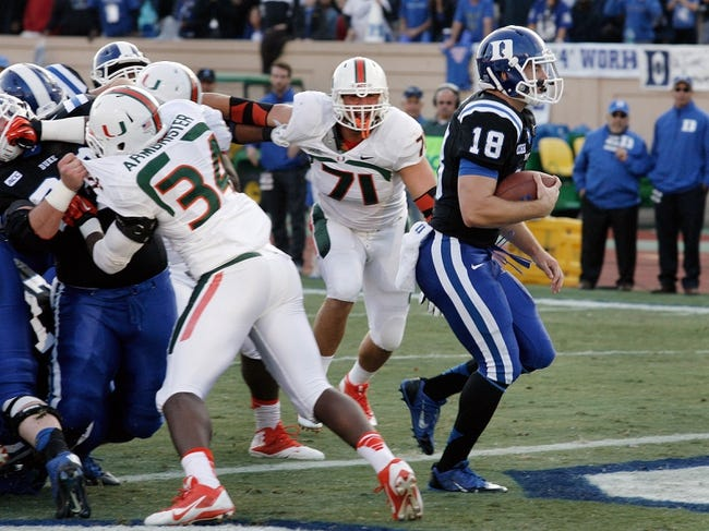 Nov 16, 2013; Durham, NC, USA; Duke Blue Devils quarterback Brandon Connette (18) runs into the end zone for a touchdown against the Miami Hurricanes at Wallace Wade Stadium. Mandatory Credit: Mark Dolejs-USA TODAY Sports