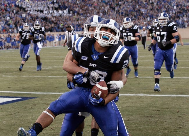 Nov 16, 2013; Durham, NC, USA; Duke Blue Devils wide receiver Brandon Braxton (5) and running back Shaquille Powell (28) celebrate after Powell scored against the Miami Hurricanes at Wallace Wade Stadium. Mandatory Credit: Mark Dolejs-USA TODAY Sports