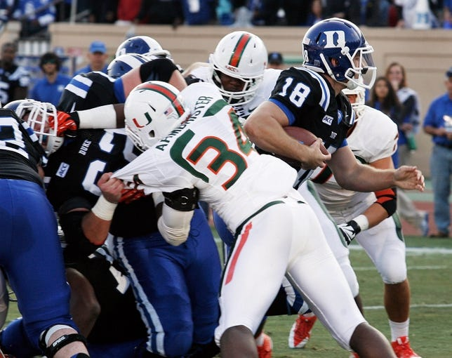 Nov 16, 2013; Durham, NC, USA; Duke Blue Devils quarterback Brandon Connette (18) squeezes into the end zone for a touchdown against the Miami Hurricanes at Wallace Wade Stadium. Mandatory Credit: Mark Dolejs-USA TODAY Sports