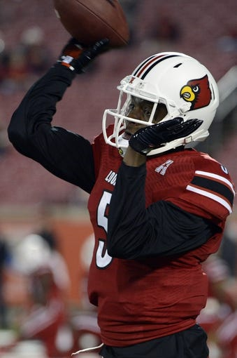 Nov 16, 2013; Louisville, KY, USA; Louisville Cardinals quarterback Teddy Bridgewater (5) warms up before the first quarter of play against the Houston Cougars at Papa John's Cardinal Stadium. Mandatory Credit: Jamie Rhodes-USA TODAY Sports