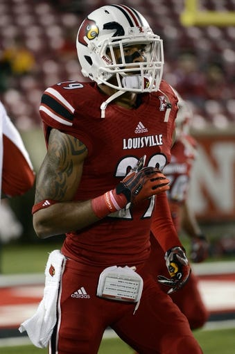 Nov 16, 2013; Louisville, KY, USA; Louisville Cardinals safety Hakeem Smith (29) warms up before the first quarter of play against the Houston Cougars at Papa John's Cardinal Stadium. Mandatory Credit: Jamie Rhodes-USA TODAY Sports