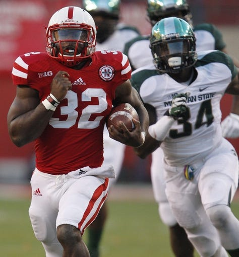 Nov 16, 2013; Lincoln, NE, USA; Nebraska Cornhuskers running back Imani Cross (32) scores a touchdown against the Michigan State Spartans in the third quarter at Memorial Stadium. Mandatory Credit: Bruce Thorson-USA TODAY Sports