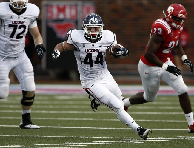 Nov 16, 2013; Dallas, TX, USA; Connecticut Huskies running back Max DeLorenzo (44) rushes against the Southern Methodist Mustangs during the second half on an NCAA football game at Gerald J. Ford Stadium. Southern Methodist Mustangs won 38-21. Mandatory Credit: Jim Cowsert-USA TODAY Sports