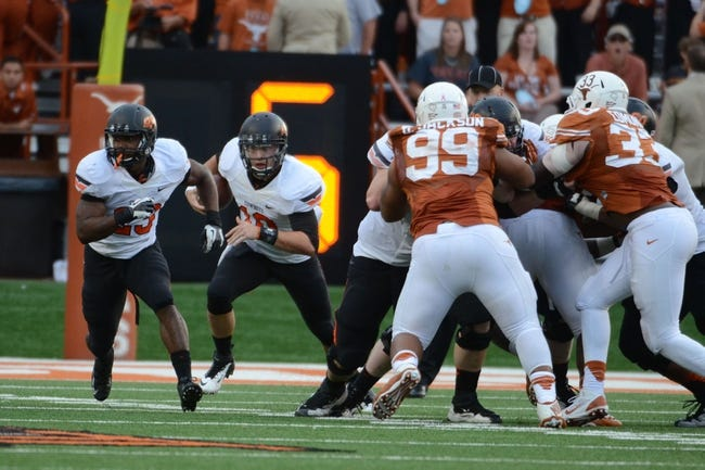 Nov 16, 2013; Austin, TX, USA; Oklahoma State Cowboys quarterback Clint Chelf (10) runs the ball against the Texas Longhorns during the third quarter at Darrell K Royal-Texas Memorial Stadium. Oklahoma State beat Texas 38-13. Mandatory Credit: Brendan Maloney-USA TODAY Sports