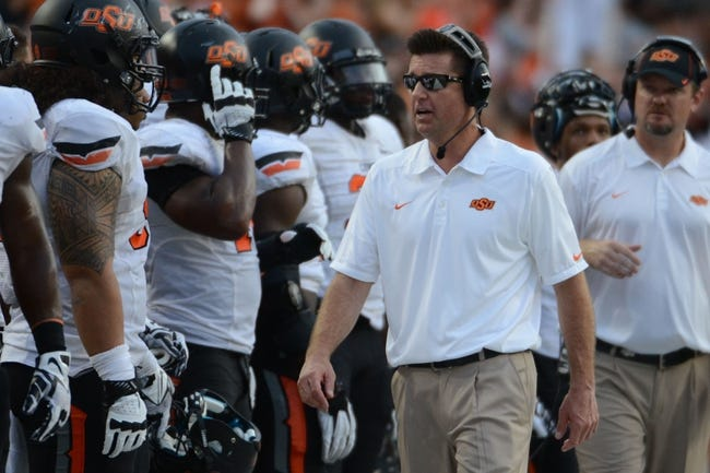 Nov 16, 2013; Austin, TX, USA; Oklahoma State Cowboys head coach Mike Gundy reacts against the Texas Longhorns during the third quarter at Darrell K Royal-Texas Memorial Stadium. Oklahoma State beat Texas 38-13. Mandatory Credit: Brendan Maloney-USA TODAY Sports